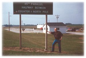 Shintangle is very close the the 45th Parallel, Halfway between the North Pole and the Equator.  Here's Jim at the marker